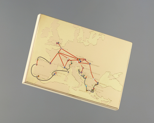 "A rose gold cigarette case bearing the inscription ""David from Wallis. Christmas 1935"" by CARTIER. Known as David to the royal family, one of the first gifts exchanged was this Christmas present from Wallis that featured a map engraved of their travels across Europe, with each capital city plotted with a cabochon gem or brilliant-cut diamond, and the destinations joined by enamelled wire."