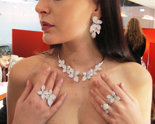 Model wearing rings, earrings and necklace in white diamonds from the Secret Garden collection, PASQUALE BRUNI
