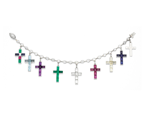 "A bracelet of nine Latin crosses set with baguette-cut diamonds, aquamarines, emeralds, rubies, yellow sapphires, and amethysts given to Wallis by the Duke between 1934 and 1944 to commemorate certain events in their lives. The backs bore dates and cryptic personal inscriptions such as ""Our Marriage Cross Wallis 3-VI-37""."