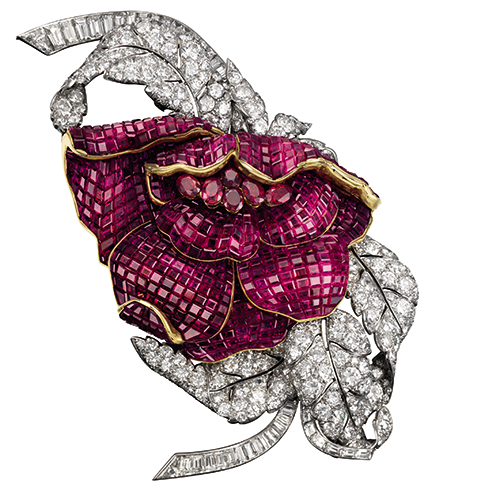 The Peony clip composed of 700 mystery-set square Burmese rubies, six oval faceted rubies, 43 baguette and 196 round diamonds. This was part of Her Royal Highness Princess Faiza of Egypt's former collection