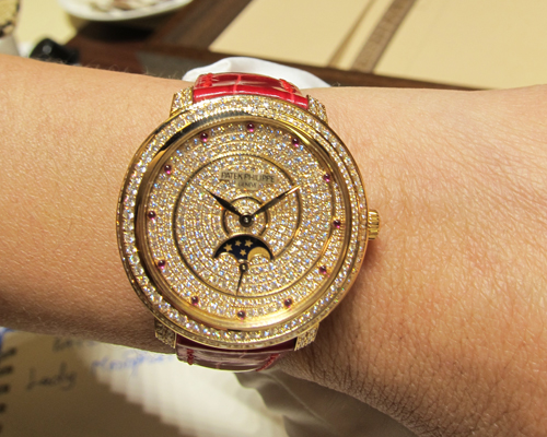 Ladies Moonphase watch in rose gold and full pave diamonds featuring ruby hour markings, PATEK PHILIPPE