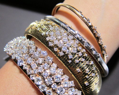Stackable diamond bracelets in white, yellow, and rose gold from the Stardust collection, CHIMENTO