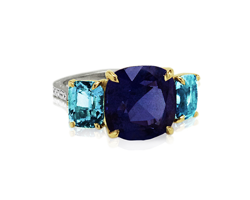 A three-stone engagement ring featuring a tanzanite centre, PAOLO COSTAGLI