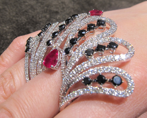 Fan ring in white gold with white and black diamonds and rubies, DAMIANI
