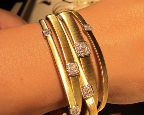 Stackable and flexible bracelets in yellow gold and diamonds, MARCO BICEGO