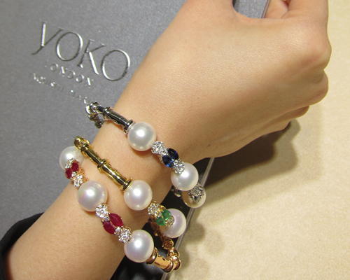 Bangles with rubies, sapphires, emeralds and South Sea pearls from the Belgravia collection, YOKO LONDON