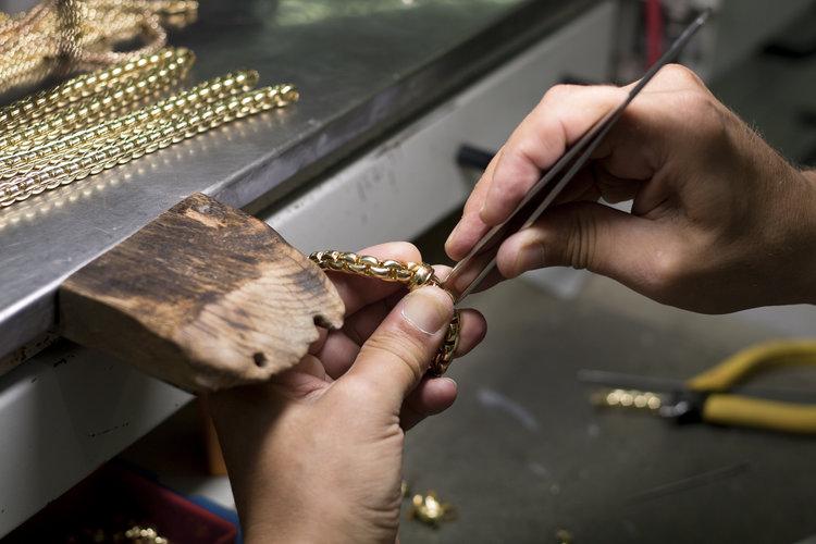 FOPE jewelley crafstman working on an Eka piece