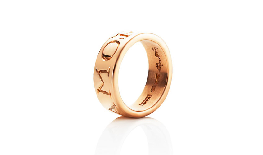 Gold ring with stamped letters Amor Fati, Latin for Love for our destiny.