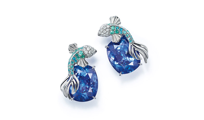 Earrings of cushion cut tanzanites with fish of round diamonds and blue caprian elbaite tourmalines