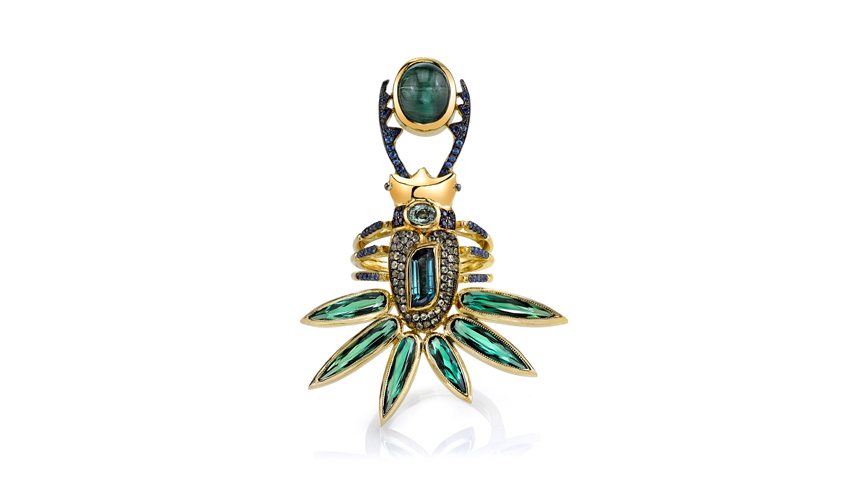 Devi ring with a 4.77ct Cat's Eye tourmaline, blue and green sapphires, peridots, tourmalines, and blue tourmalines