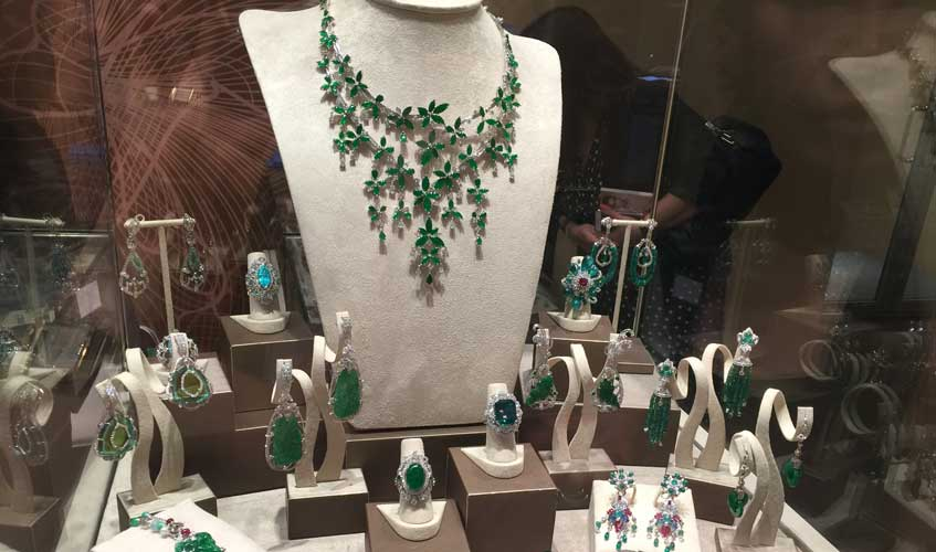 A mixture of emerald and jade stones in a collection, DILYS'