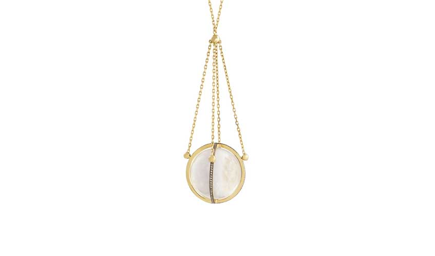Rock crystal quartz sphere segmented into four sections by a setting of 18K yellow gold with white diamonds finished in black rhodium chain to 18K yellow gold from Tilsam collection