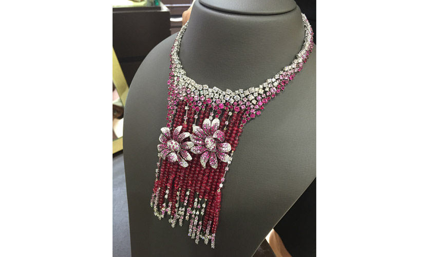 A masterpiece by DE AMBROSI featuring pink sapphires, ruby beads and white diamonds on white gold, available at Jocalia by Zenith Affair
