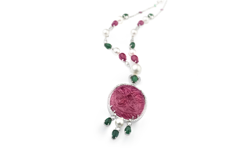 Necklace in white gold with diamonds, pearls, rubies, emeralds, and one oval carved ruby