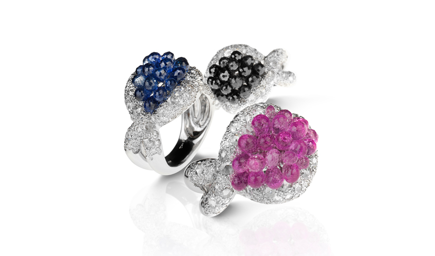 Rings in white gold with diamonds, pink and blue sapphire briolettes, and black diamond briolettes