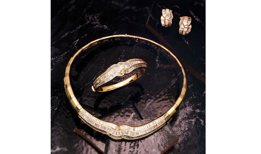 A set of vintage collar necklace, bracelet, and earrings in yellow gold and diamonds